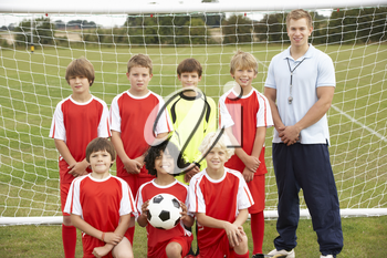 Junior soccer team and coach portrait