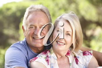 Portrait Of Senior Couple Relaxing In Countryside