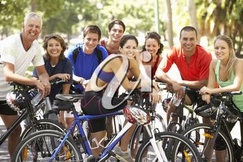 Group Of Cyclists Resting During Cycle Ride Through Park