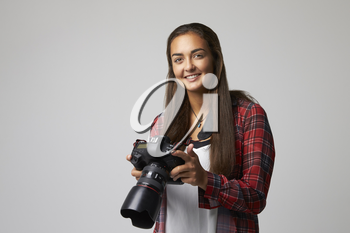 Studio Portrait Of Female Photographer With Camera