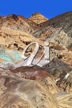 Multi-colored rocks in Death Valley, USA. The famous road Artists  Palette