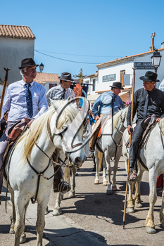 Sent-Mari-de-la-Mer, Provence, France - May 25, 2015. World Festival of Gypsies. Convoy on white horse before start of the parade. The concept of ethnographic tourism