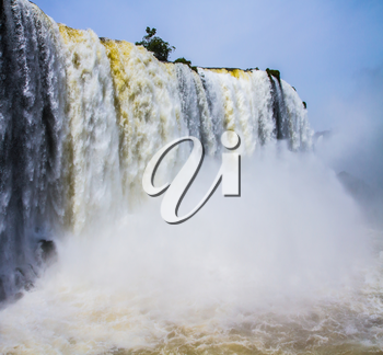 Border of Argentina, Brazil and Paraguay. Concept of active and extreme tourism. Huge complex of waterfalls Iguazu on the border of three countries