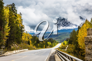 The astonishing road 93 Icefields Parkway passes among the snow-capped mountains. The grandiose nature of the Rockies of Canada. The concept of active and automobile tourism