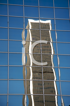 Royalty Free Photo of a Skyscraper Reflected in Another Skyscraper