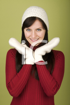 Royalty Free Photo of a Woman Wearing a Winter Hat and Mittens