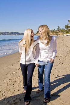 Royalty Free Photo of Two Blonde Women on the Beach