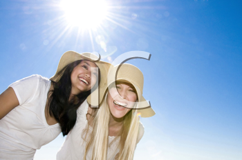 Royalty Free Photo of Two Laughing Women in Hats