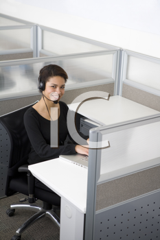 Royalty Free Photo of a Woman on a Headset in a Cubicle