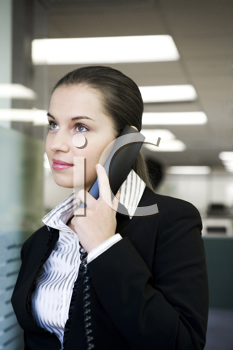 Royalty Free Photo of a Young Woman Talking on an Office Phone