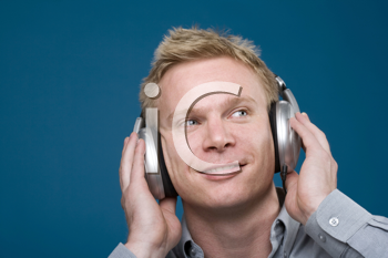 Royalty Free Photo of a Man Listening to Headphones