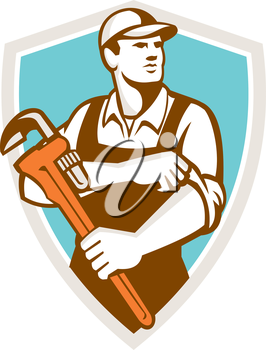 Illustration of a plumber wearing hat holding monkey wrench rolling sleeve looking to the side set inside shield crest on isolated background done in retro style.