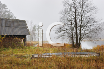 Royalty Free Photo of an Outbuilding and Country Field on a Misty Morning