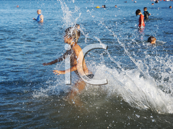 Royalty Free Photo of a Child Splashing in the Water