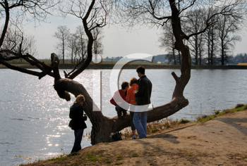 Royalty Free Photo of Young People at a Pond in Spring