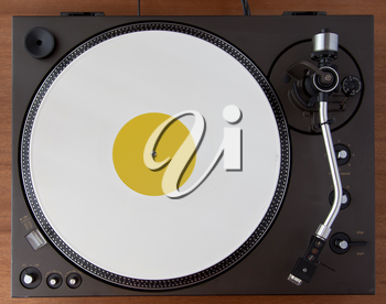 Vintage Record Turntable Player With White Vinyl Disk Top View