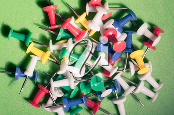 closeup shot of mixed colors office push-pins, may be used as background, toned image, vintage look
