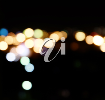 City lights in the background with blurring spots of  light a lot of copyspace.