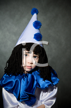 Royalty Free Photo of a Child in a Clown Costume