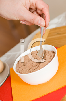 Royalty Free Photo of a Person Making Dessert