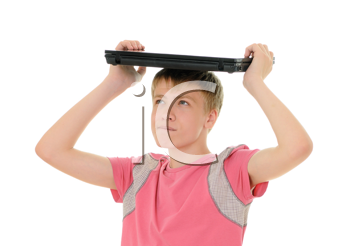 Royalty Free Photo of a Teenager Balancing a Laptop