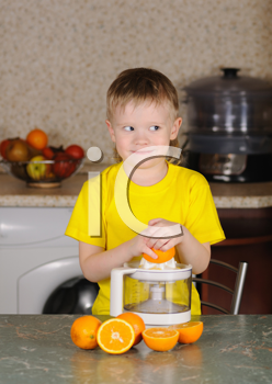 Royalty Free Photo of a Child Using a Juicer