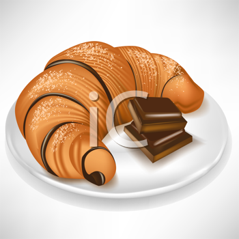 croissant with chocolate pieces on plate