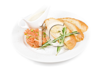 Tar-tar from salmon fish with green onion. Served with honey sauce and white bread toast.