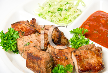 Royalty Free Photo of Grilled Meat With Vegetables and Sauce