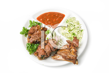 Grilled meat with sauce and vegetables isolated on white background