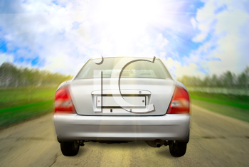 Royalty Free Photo of a Car Driving