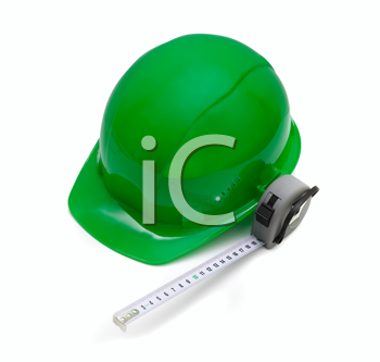 Royalty Free Photo of a Green Safety Helmet and Measuring Tape