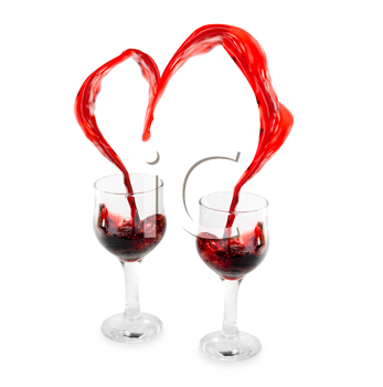 Royalty Free Photo of a Heart From Pouring Red Wine