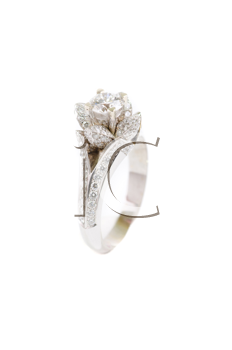gold ring with gem on a white