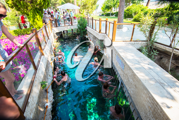 Pammukale, Turkey- July, 2015: Tourists swim in antique Cleopatra pool. Color of water is caused by the presence of a large amount of radon.