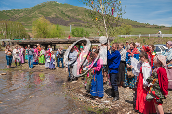TOPOLNOE, ALTAY, RUSSIA - May 27, 2018: Folk festivities dedicated to the feast of the Holy Trinity. Ancient Russian rite: sinking a birch.
