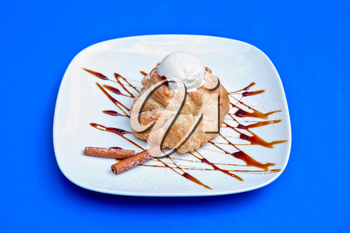 apple strudel with ice cream at blue background