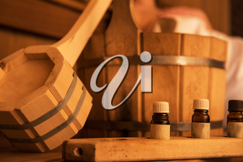 Wooden bath accessories with aromatic oil bottle for bath in the sauna