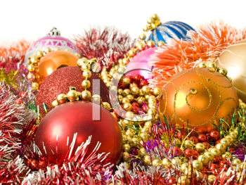 Christmas colorful decoration - baubles, tinsel and beads over white