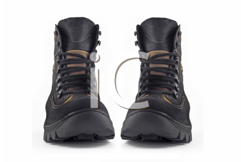 Front view of pair of Warm leather boots for wearing in winter or traveling (isolated, over white)