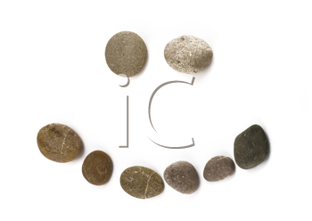 Positive funny emoticon assembled of pebble isolated over white