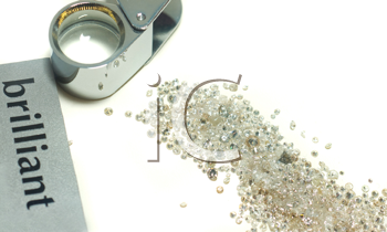 Sorting of gems - diamonds and loupe over white