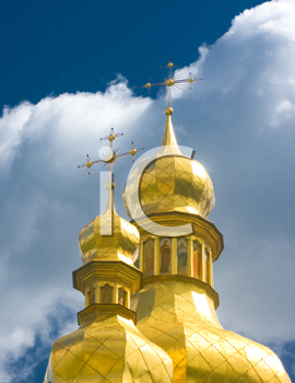 Ukraine, Golden Cupola of Orthodox church and blue sky with clouds