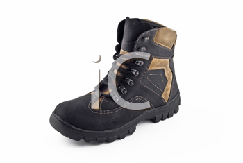 Warm leather boot for wearing in winter or traveling isolated over white