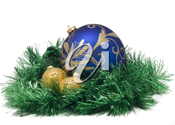 Three Beautiful Christmas or New Year balls in green tinsel over white
