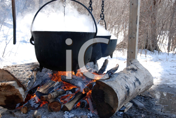 Royalty Free Photo of a Kettle and Open Fire