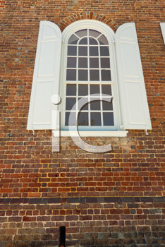 Royalty Free Photo of a Window in a Brick Wall