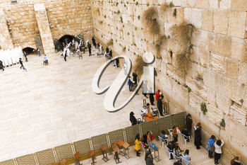 Jerusalem, Israel-March 14, 2017: The Western Wall is the holiest place where Jews are permitted to pray, though it is not the holiest site in the Jewish faith, which lies behind it, on Temple Mount.