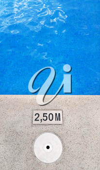 Background of swimming pool with marking depth on concrete border