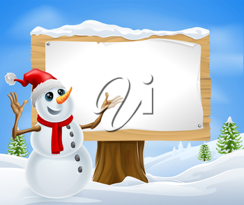 Christmas snowman with Santa hat in snowy landscape with sign